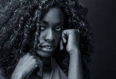 Sad African Girl. Portrait of a scared or depressed black girl Royalty Free Stock Image