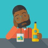 Sad african man alone in the bar drinking beer Royalty Free Stock Photos