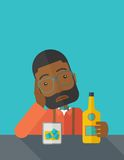 Sad african man alone in the bar drinking beer Stock Photo