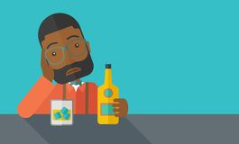Sad african man alone in the bar drinking beer Royalty Free Stock Photo