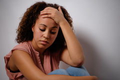 Sad afro-american woman portrait. On background Royalty Free Stock Image