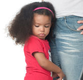 Sad afroamerican girl hugging an adult Stock Photos