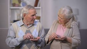 Sad aged couple counting coins, needing money for life, social insecurity stock video