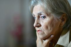 Sad aged woman Royalty Free Stock Image