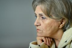 Sad aged woman. At home Royalty Free Stock Photos