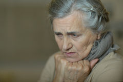 Sad aged woman Stock Images