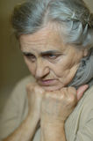 Sad aged woman Stock Photo