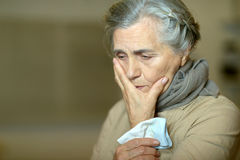 Sad aged woman. Portrait of a cute sad aged woman Stock Photography