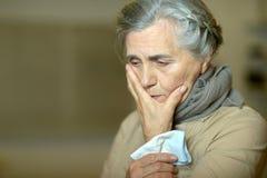 Sad aged woman Stock Photography