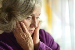 Sad aged woman Stock Photo