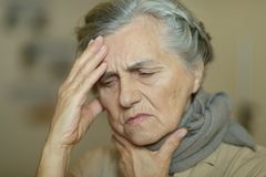 Sad aged woman. Portrait of a sad aged woman ill royalty free stock photos