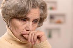 Sad aged woman Stock Images