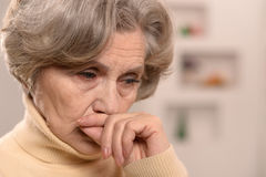 Sad aged woman Stock Photos
