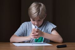 Sad and aggressive. Young boy is very sad and aggressive Royalty Free Stock Images