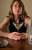 Sad alcoholic woman Stock Photo