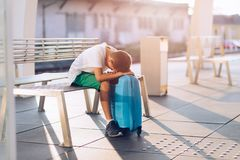 Sad alone boy child waiting alone with his baggage stock images