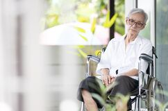 Free Sad And Depressed Asian Senior Woman Sitting Alone In Wheelchair With Head Down Feel Lonely And Bored,disabled Old Elderly With Stock Images - 201289004