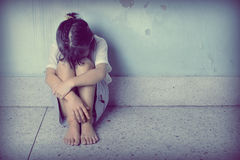 Free Sad And Depressed Little Girl Sitting Near The Wall Royalty Free Stock Photos - 34480298