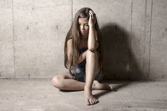 Free Sad And Lonely Girl Beside Wall Stock Photos - 75155573