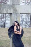 Sad angel. Black sad angel on the cemetery Stock Image
