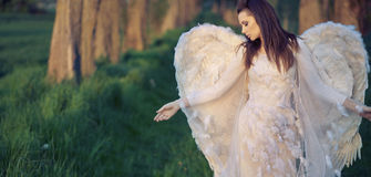 Sad angel in the bosom of nature stock photo