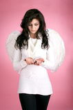 Sad angel with a feather Stock Images