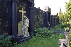 Sad angel guards monumental grave. Cemetery in Berlin/Germany, Bergmannstraße. Here the philosopher Friedrich Schleiermacher, the artist Martin Gropius, is royalty free stock photo