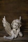 Sad angel: idea for a greeting or condolence card. Stock Photos