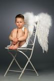 Sad angel kid Stock Images