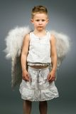 Sad angel kid with white wings Stock Images