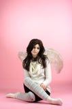 Sad angel sitting on the floor Stock Photo