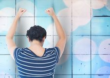 Sad angry woman grief banging fists against a blue wall Stock Image