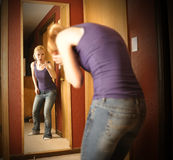 Sad Angry Woman in Mirror Royalty Free Stock Photo