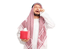 Sad Arab crying and wiping his tears Stock Images