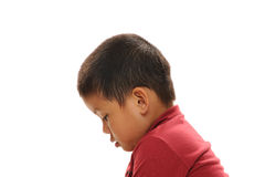 Sad asian boy. Asian boy looking sad profile view with red shirt Royalty Free Stock Images