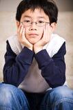Sad asian boy stock photos