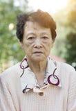 Sad Asian elderly woman Stock Images