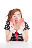 Sad Asian girl tear heart shape paper Royalty Free Stock Images
