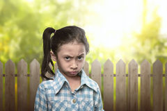 Sad asian kid in blue clothes with disbelief expression Stock Photography
