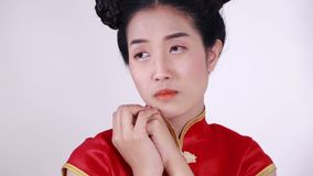 Sad asian woman in cheongsam dress. Sad asian woman in chinese cheongsam dress stock footage