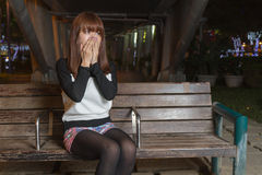 Sad Asian Woman on a Park Bench Stock Image