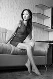 Sad asian woman on sofa Stock Photos