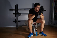 sad athlete tired to act pensively sitting at gym Stock Photography