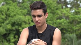 Sad Athletic Male Hispanic Teenager. A handsome hispanic male teen stock footage