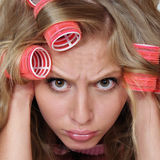 Sad attractive girl with hair curlers Royalty Free Stock Image