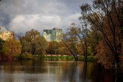 A sad autumn park in cloudy weather royalty free stock photo
