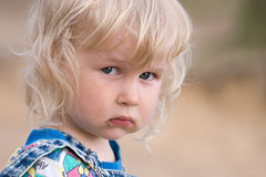 Sad baby. Portrait of two years old sad blonde girl Stock Images