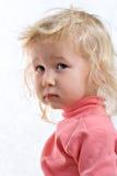 Sad baby. Close-up portrait of sad baby on white background Stock Image