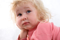 Sad baby. Close-up portrait of sad baby on white background Stock Photography