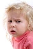 Sad baby. Close-up portrait of sad baby on white background Royalty Free Stock Photo